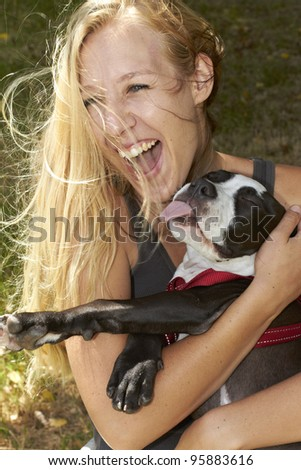 Very happy young lady and her Pit Bull dog breed - stock photo