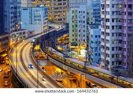 very high-speed train go through the HongKong financial center - stock photo