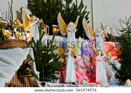 Very large christmas nativity crib. Trumpeting angels - stock photo