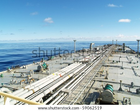 very large crude carrier transporting oil over ocean - stock photo