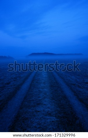 very misty landscape early in the morning  - stock photo