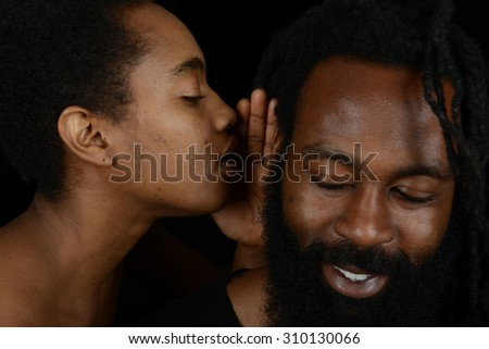 Very Nice fun Image Of a woman whispering into her boyfriends ear...I love you