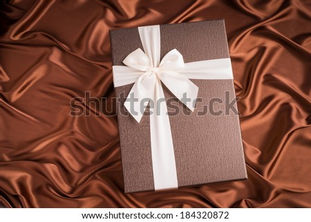 very nice gift box on silk cloth with chocolate color