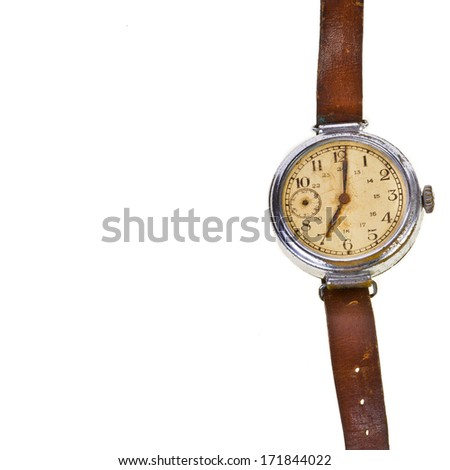 very old broken vintage wristwatch with a leather strap  isolated on white background  - stock photo