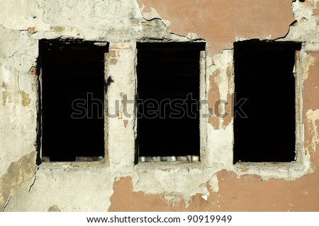 Very old building windows without glasses - stock photo