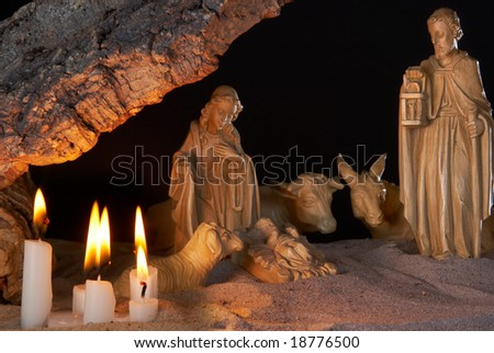 Very old christmas stable, with cork roof and candles - stock photo