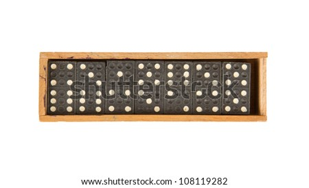 Very old domino in wooden box against the white background - stock photo