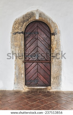 Very old door closed on Czech castle - stock photo
