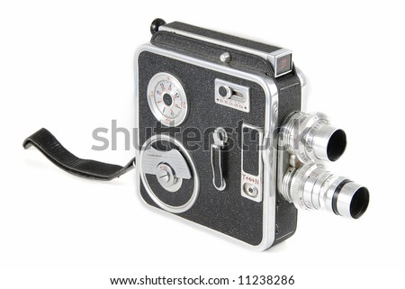 Very old double-lens 8mm video camera isolated - stock photo