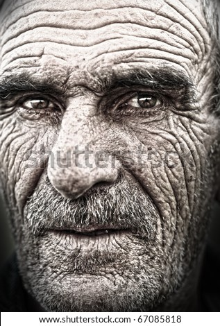 Very old face - very old photo. Portrait, elderly man with huge wrinkles on face. Some grain added. - stock photo