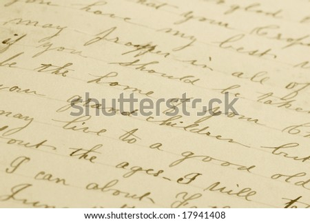 "Very old handwritten letter. Shallow depth of field with focus on ""grand children."""
