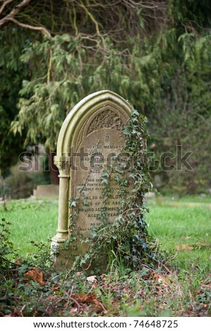 Very old headstone in a Graveyard - stock photo