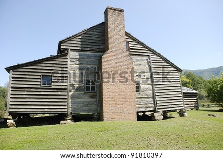 Very Old Log House Has Additions With Rough Plank Siding