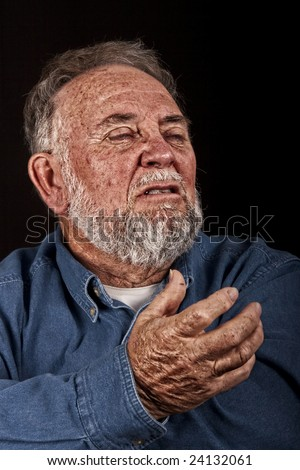 very old man angry and grieving, over black - stock photo