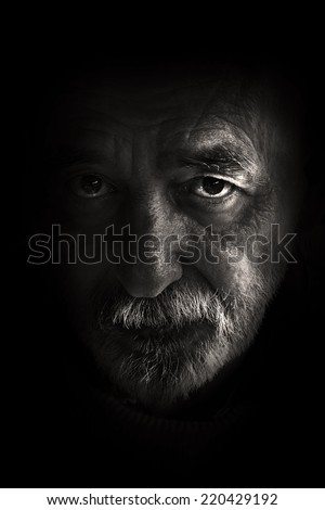 Very old man portrait on black background