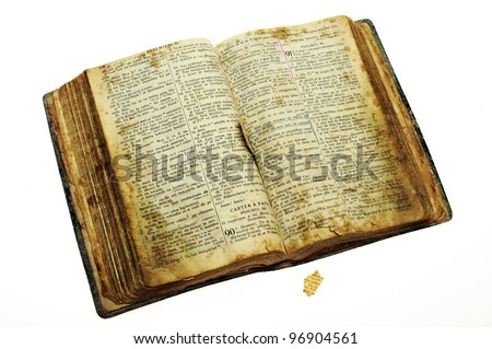Very old open bible book isolated on white - stock photo