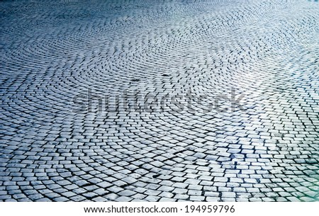 Very old roman stone pavement in the downtown of Rome, Italy - stock photo
