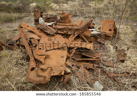 Very old, rusted, broken down machinery left on a protected heathland in Dorset, England.
