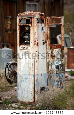 Very old rusty derelict petrol pump - stock photo