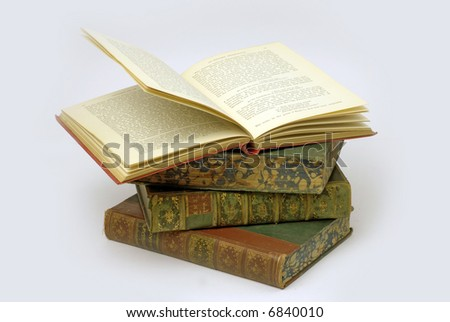 Very old textreference book lying open stock photo royalty free very old textreference book lying open atop pile of vintage leather bound ccuart Images