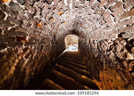 Very old tunnel in a historical fort building - stock photo
