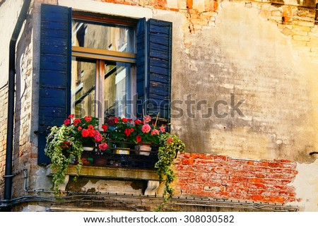 very old window in a building. Quarter of Venice. Italy - stock photo