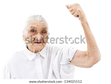 very old woman showing her muscles on her arms - stock photo