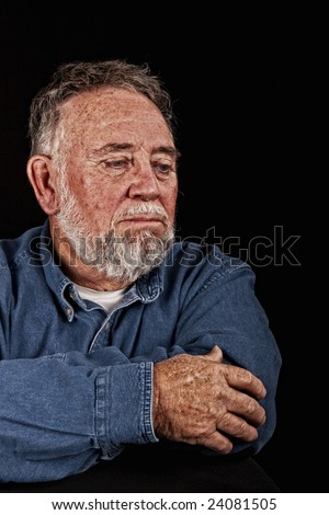 very old wrinkled man in sadness - stock photo