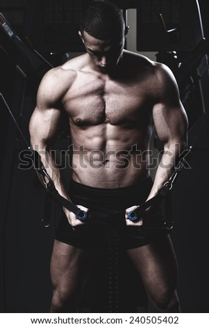 very power athletic guy, execute exercise in sport hall  - stock photo