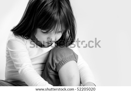 very sad little girl - stock photo