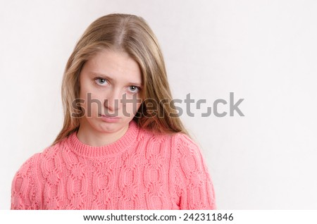 Very sad young girl - stock photo
