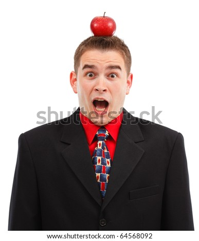 Very scared business man being target with red apple on the head - stock photo