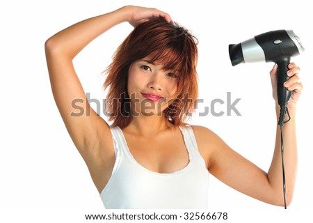 Very seductive young asian woman with a hair dryer