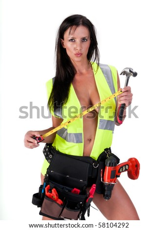 Very sensual woman with safety vest and tool. All logos removed. - stock photo