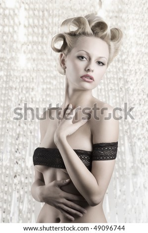 very sexy and beautiful blond woman with a pretty fashion hair style wearing a black lace as a braaround her naked body - stock photo