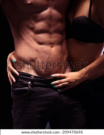 Very Sexy Bodies Close Up Portrait. Posing for Fashion Jeans. - stock photo
