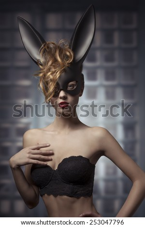very sexy woman posing in glamour easter portrait with mysterious bunny mask and lace fashion lingerie  - stock photo
