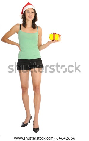 Very sexy young woman in hot pants standing with christmas present in her hand and santa hat. Isolated on white background. - stock photo