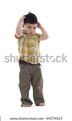 very shy boy standing over white background