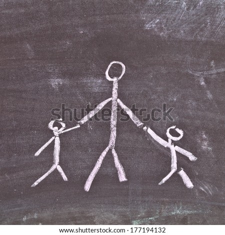 Very simple chalk sketch depicting a single parent with two young children - stock photo