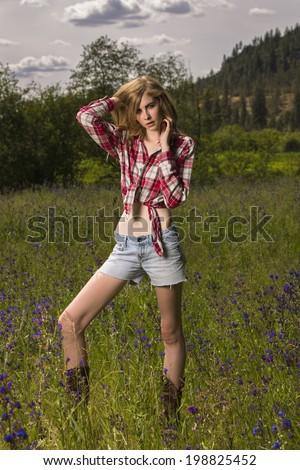 Very skinny all caucasian female model posing outdoors - stock photo