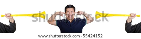 very stressed man blocking out noise from vuvuzela - stock photo