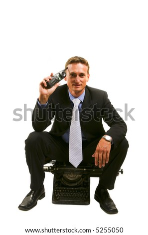Very successful businessman with phone sits on an ancient typewriter - stock photo