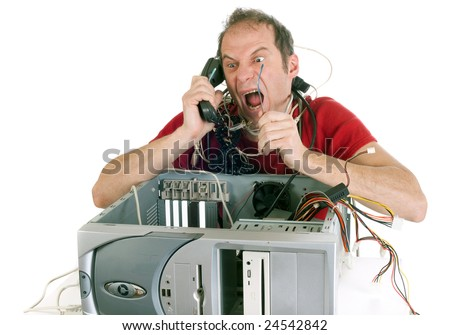 very upset man lost in computer cables yelling at hotline support - stock photo