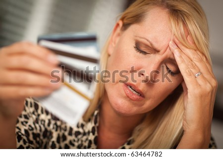 Very Upset Woman Holding Her Many Credit Cards. - stock photo