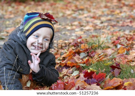 Very very cute smiling 5 years old boy in park - stock photo
