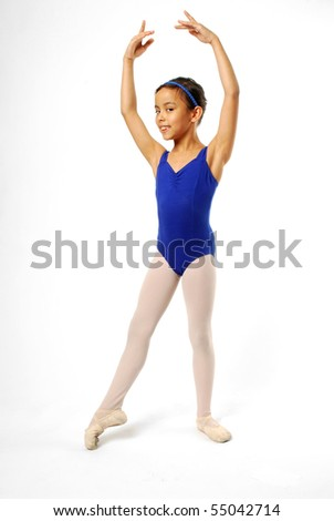 Very Young Ballerina Posing on White Background - stock photo