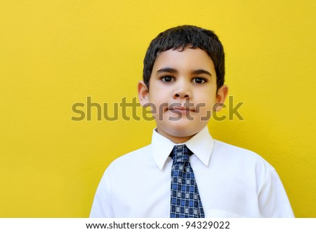 Very young business man with an optimistic expression - stock photo