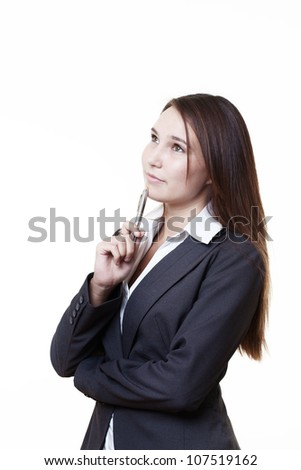 very young looking woman in a suit just starting out trying in business thinking how her future going to turn out - stock photo