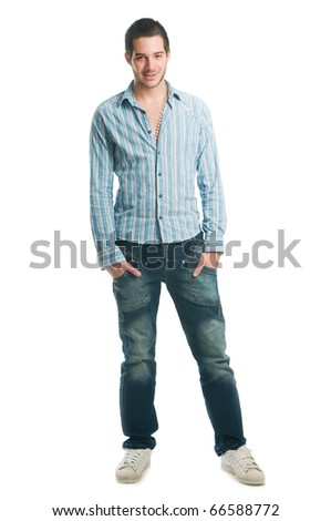 Very young men standing and holding hands in pocket against a white background, front view shot - stock photo